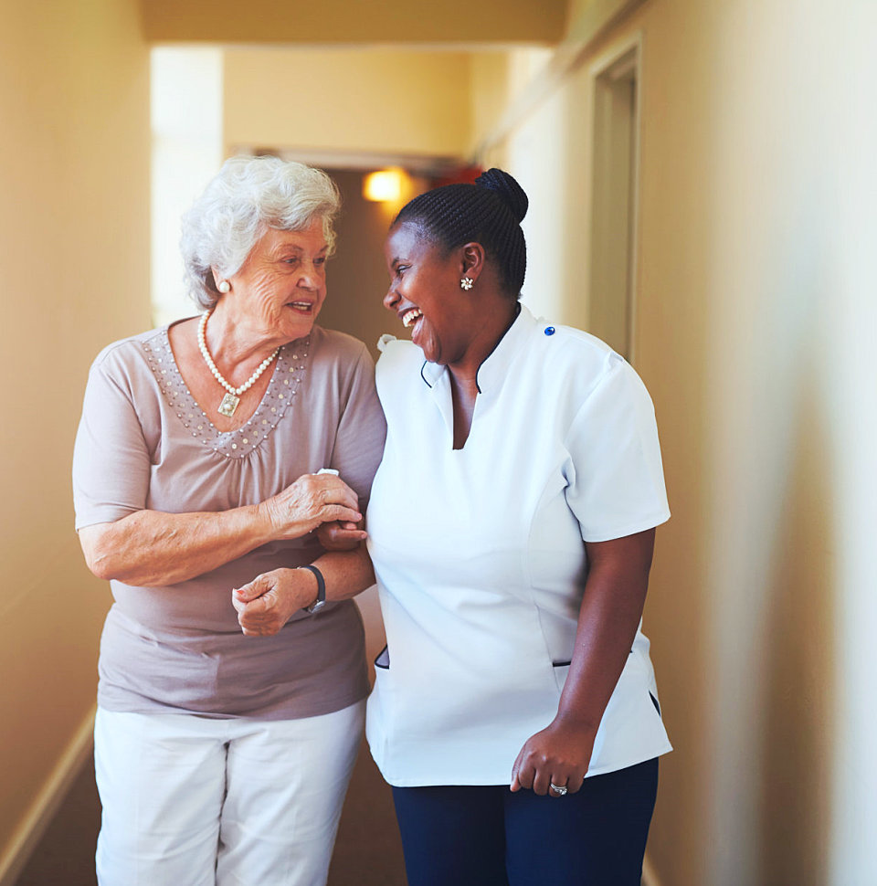 caregiver and senior smiling