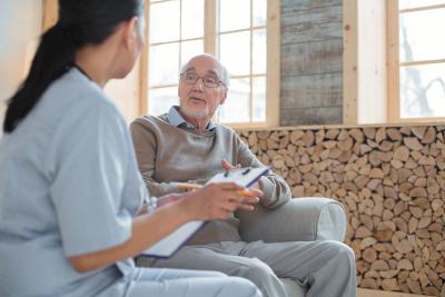 nurse talking to a senior